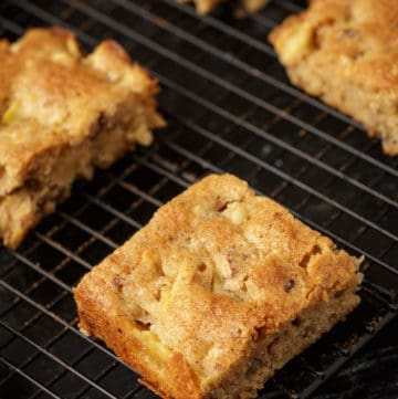 Buttery apple blondies on a cooling rack