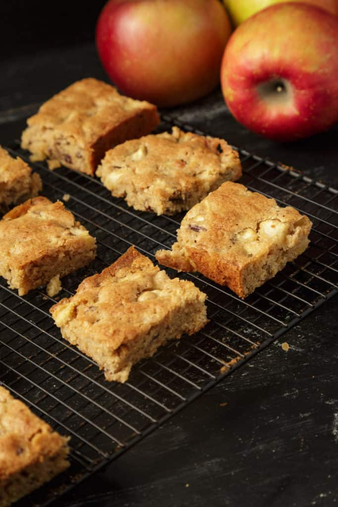 A batch of apple blondies cooling on a rack