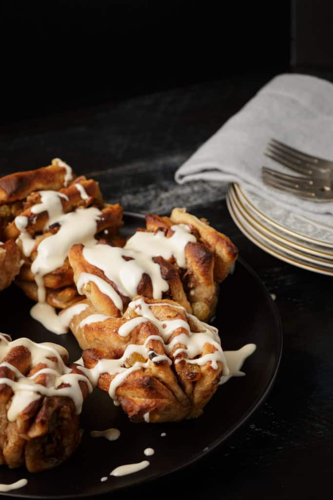 apple cinnamon rolls with plates and forks