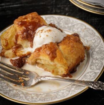 A dessert plate with an apple dumpling.