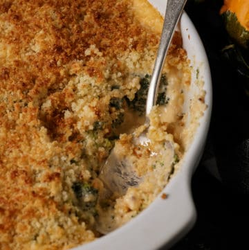 A baking dish of cheesy broccoli casserole.
