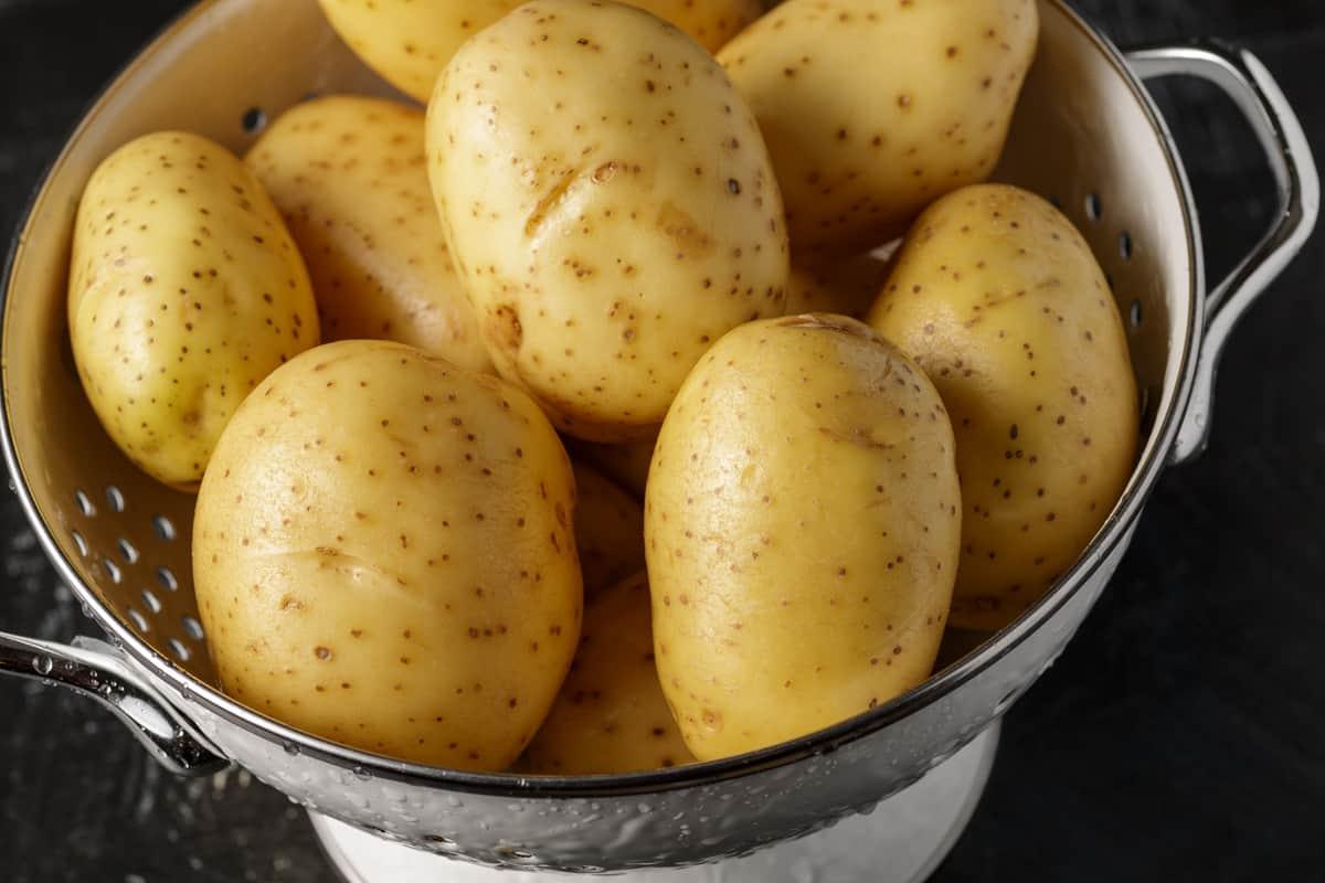 A colander of yukon gold potatoes