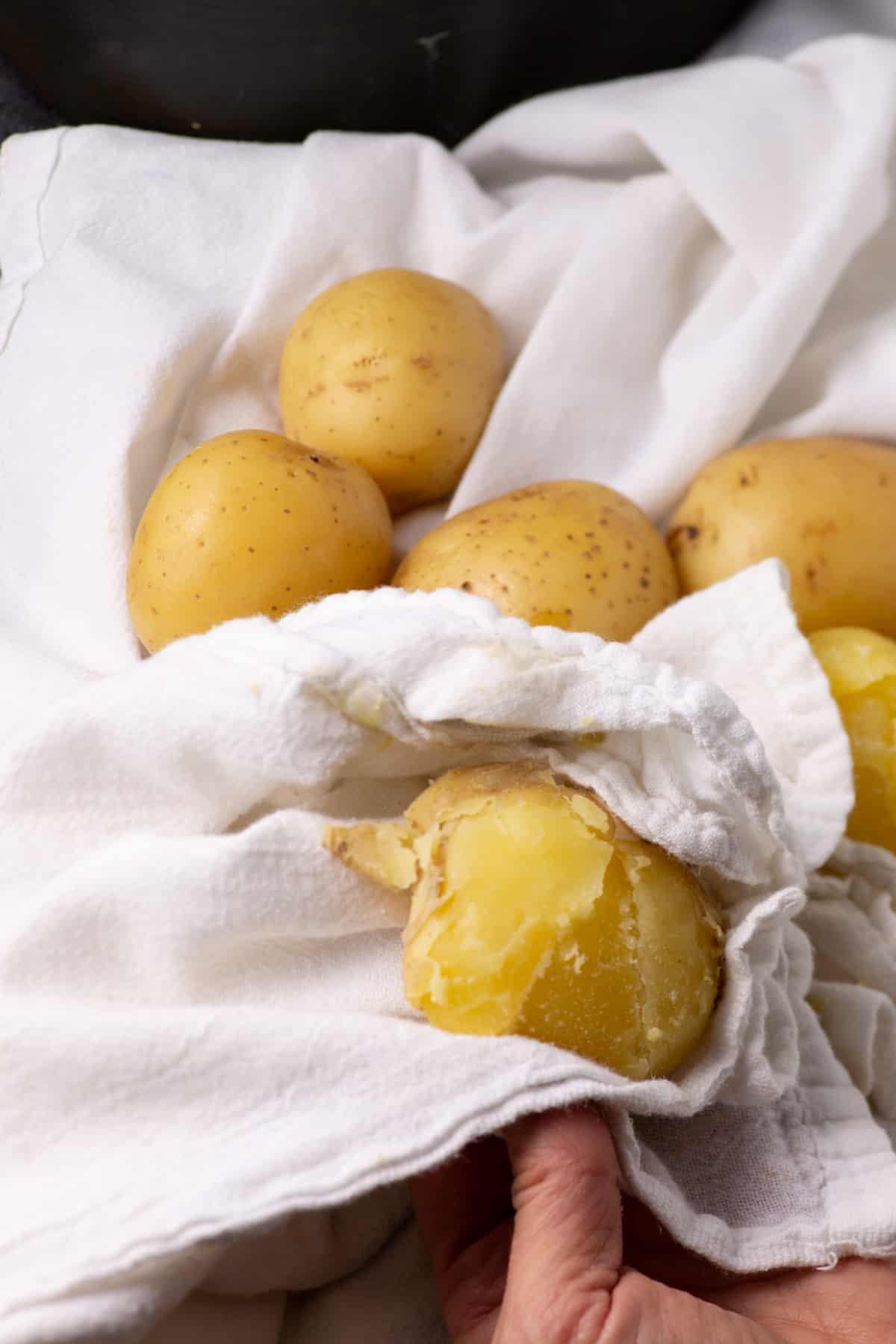 Rubbing the skin off potatoes