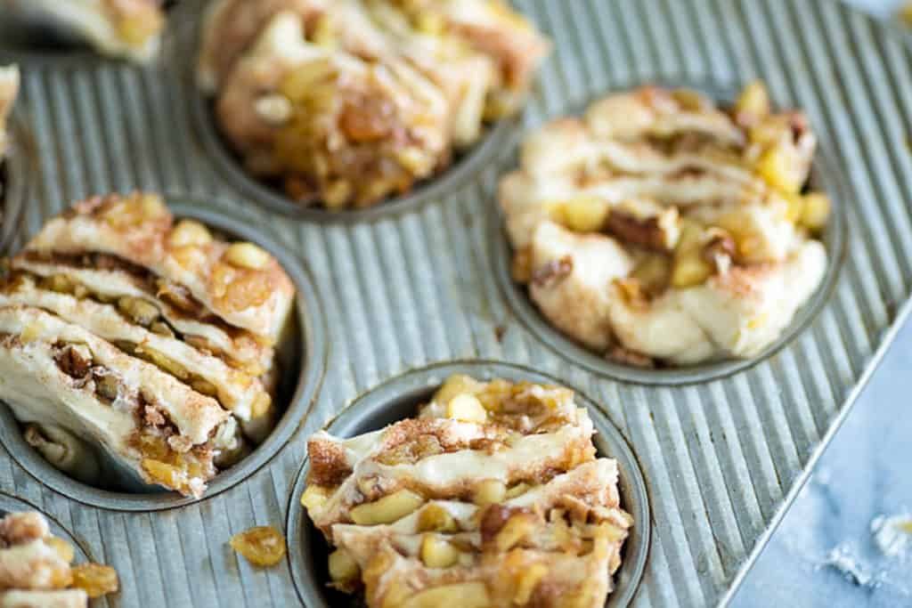 Cut cinnamon roll dough in a muffin pan
