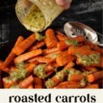 A platter of roasted carrots with dressing being poured over them
