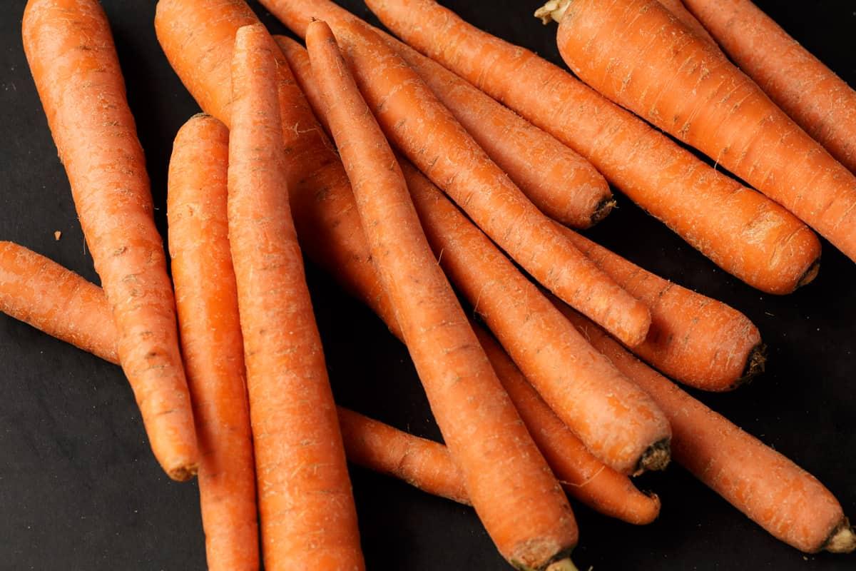 Raw carrots on a cutting board