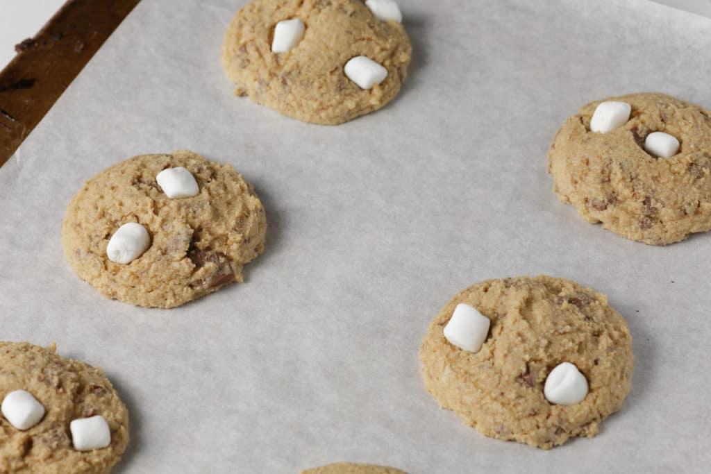 marshmallows on half baked cookies