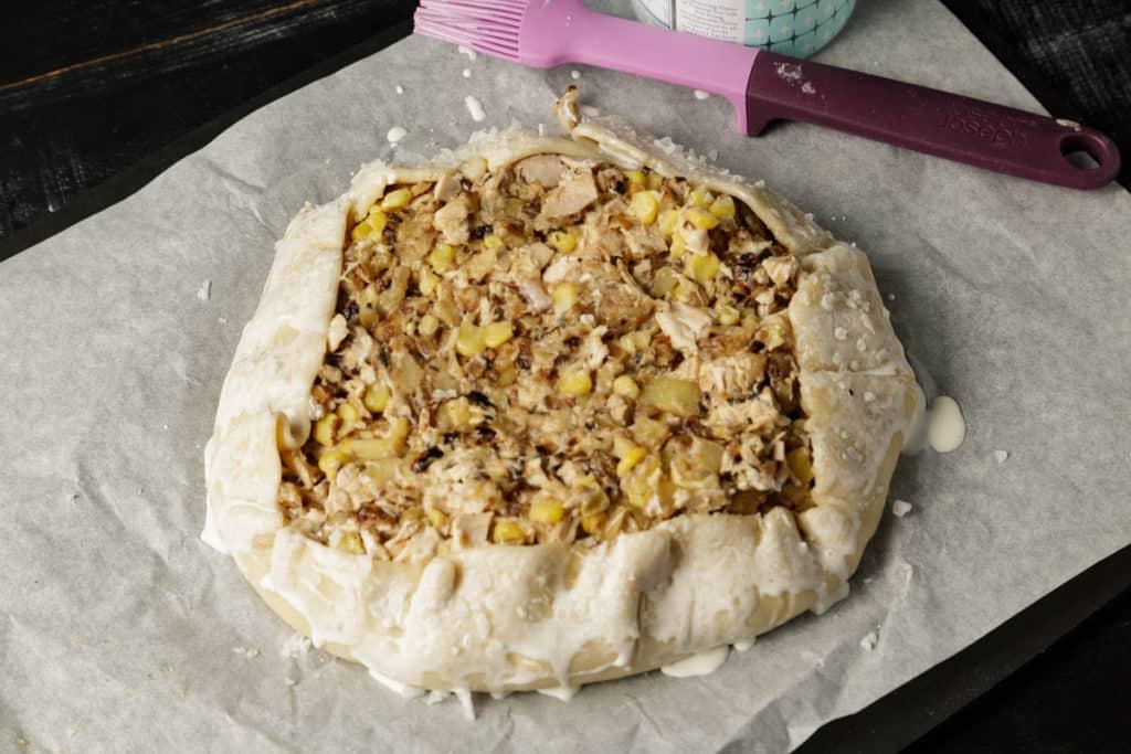 a pie crust around a chicken pot pie