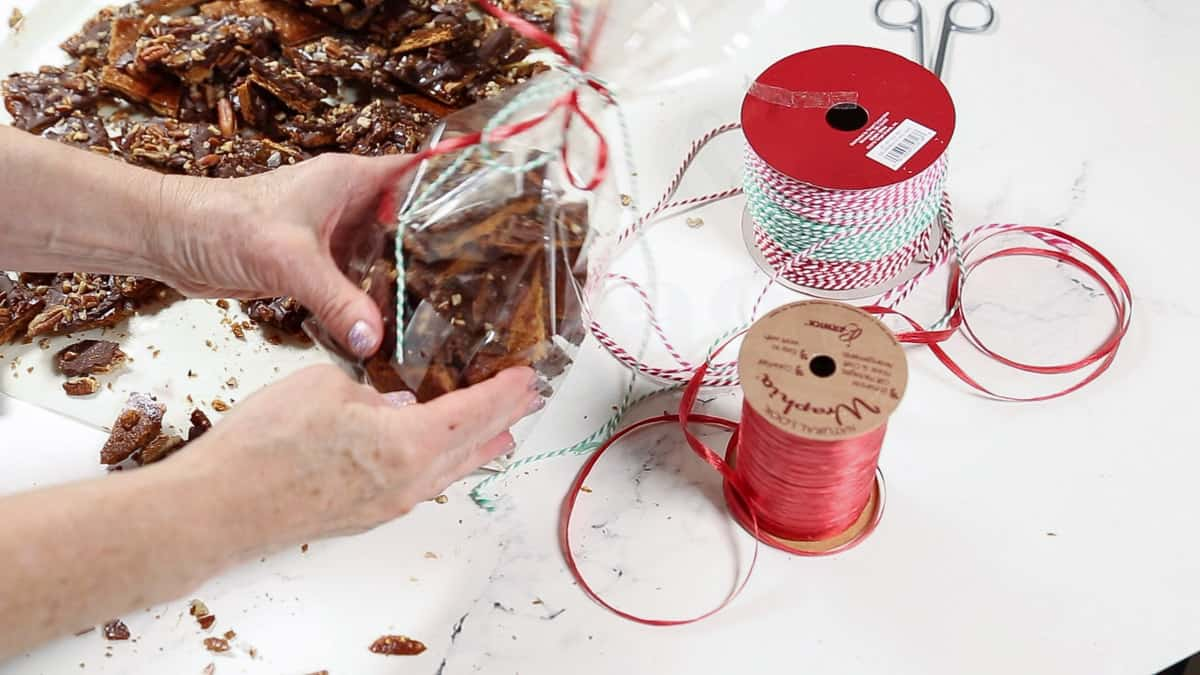 Christmas bark being wrapped in a gift bag