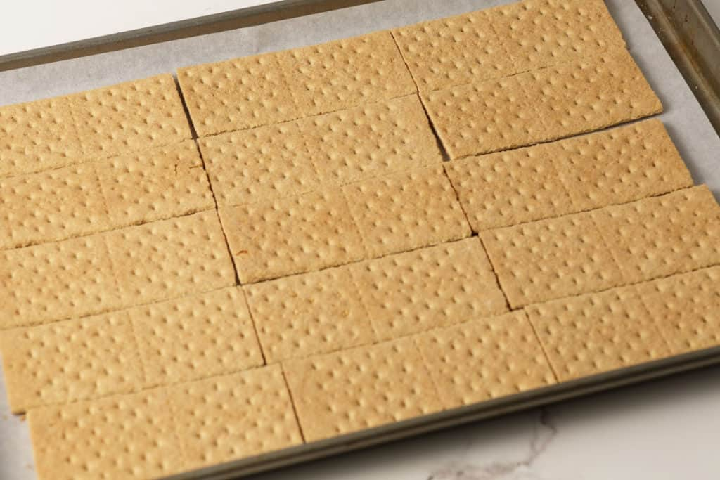 Graham crackers lined up for a batch of chocolate bark