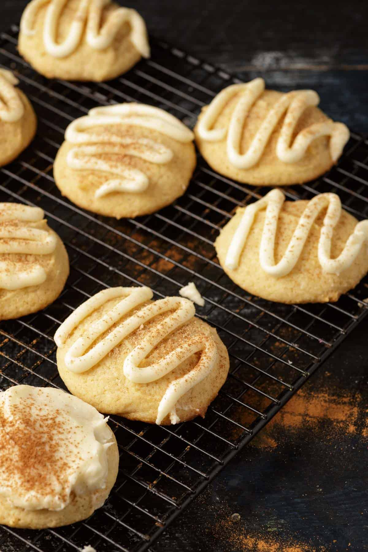 frosting piped onto eggnog cookies