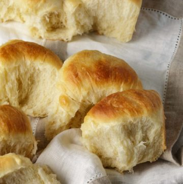 A batch of yeast rolls in a linen napkin