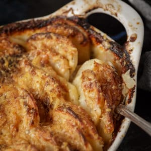 A casserole dish of potatoes au gratin