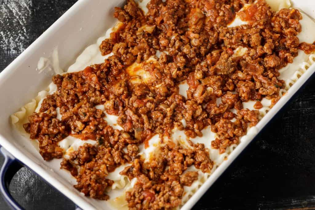 A layer of meat sauce