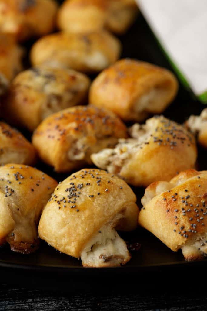 Baked crescent roll appetizers on a platter