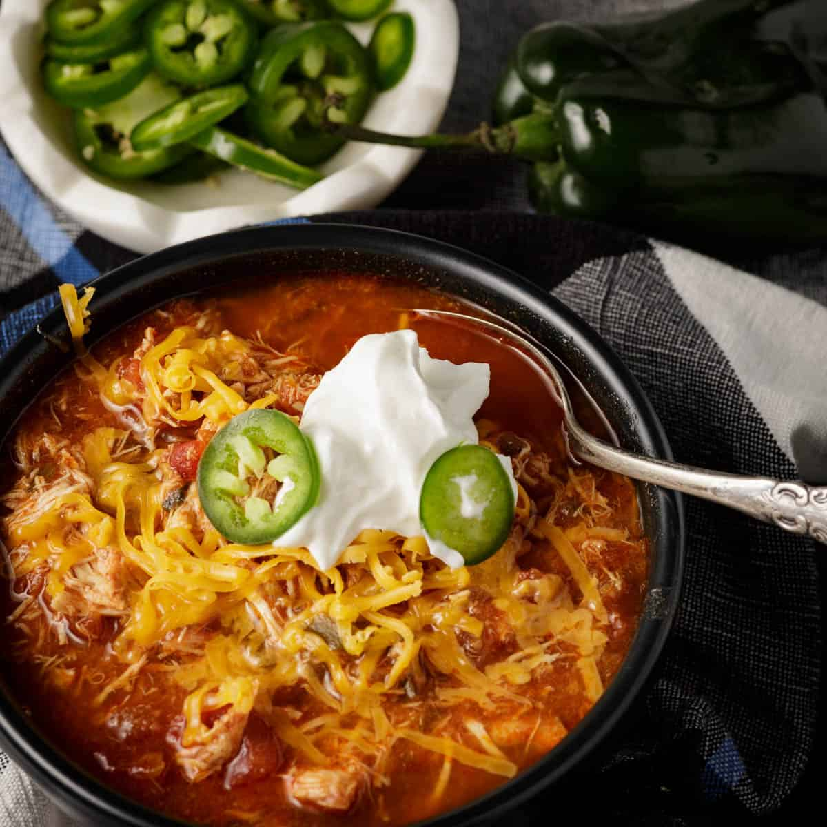 A bowl of easy slow cooker chili with sliced jalapenos