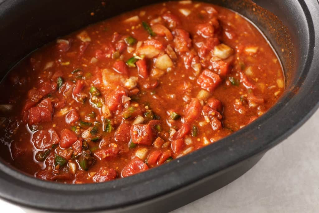 A slow cooker with all the chili ingredients added