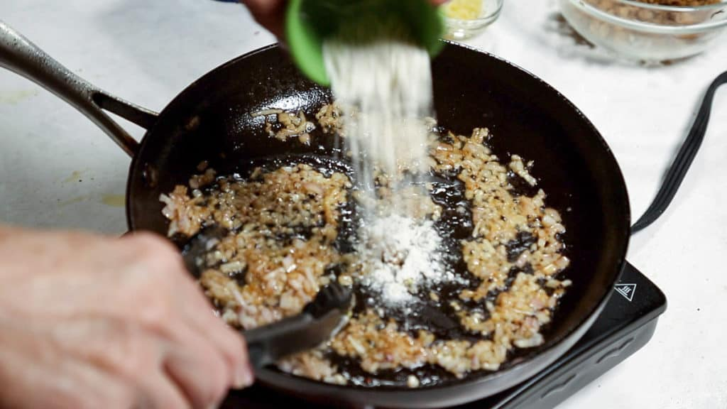 Shallots, garlic and flour in a skillet