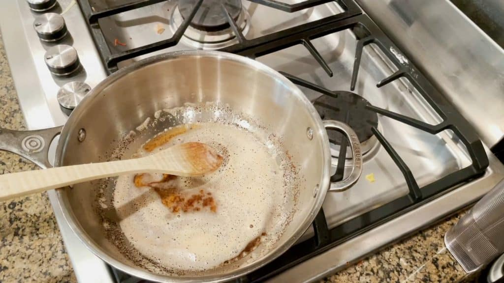 A pan of brown butter for coconut cookies