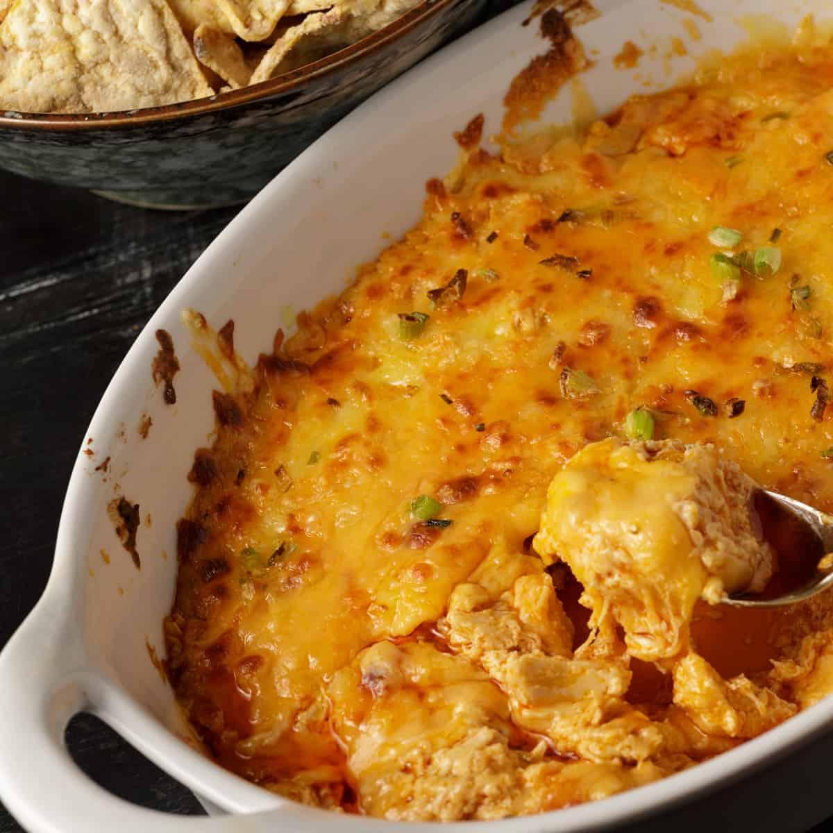 A baking dish of creamy Buffalo chicken dip