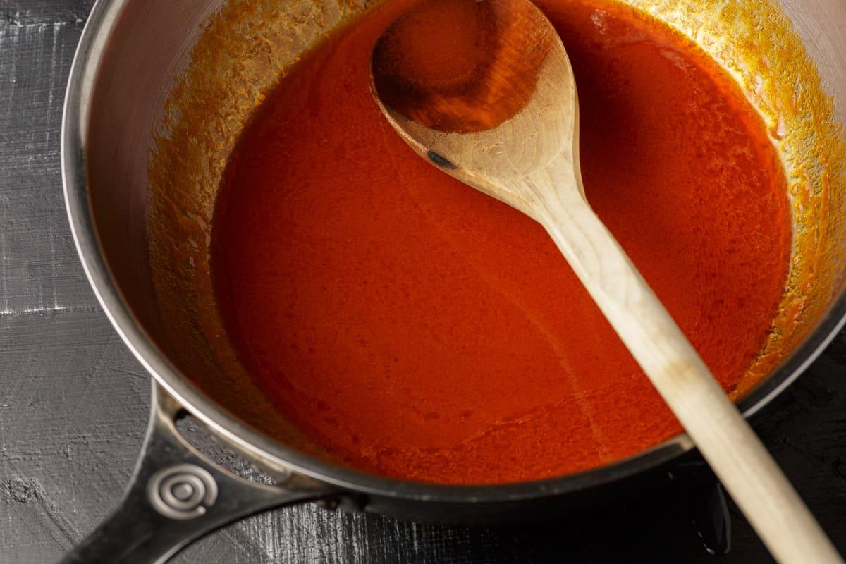 A saucepan of buffalo sauce