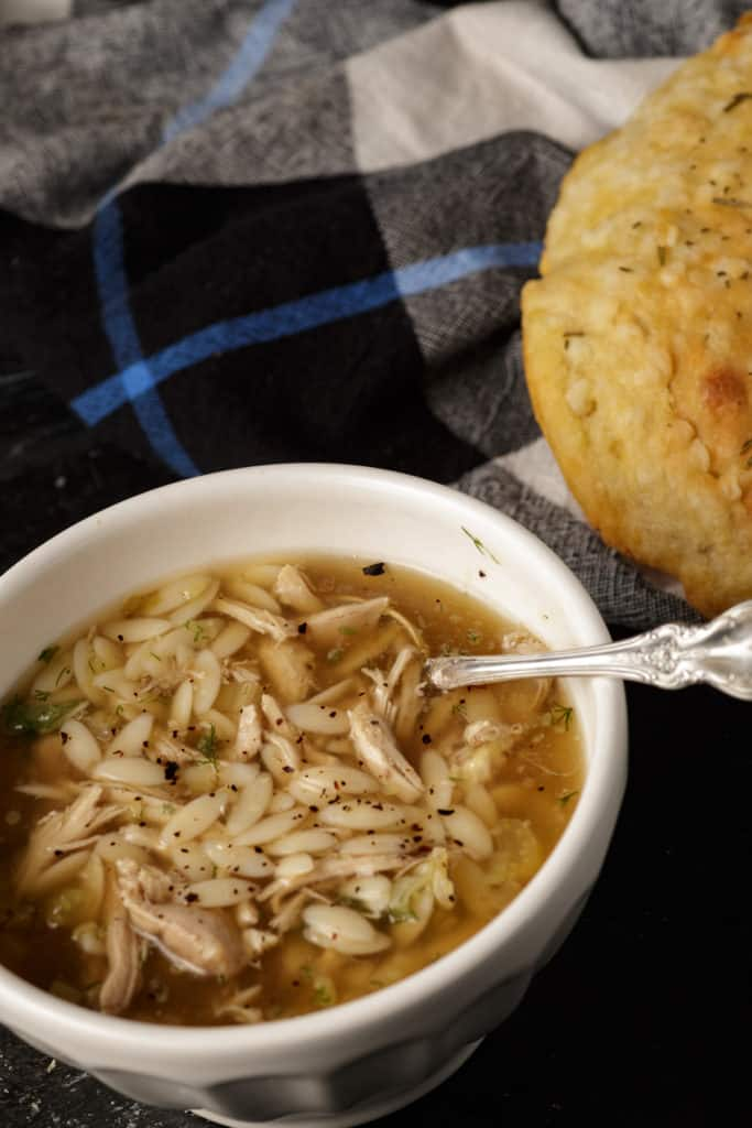 Chicken soup with a loaf of bread