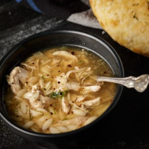 A bowl of lemon orzo chicken soup