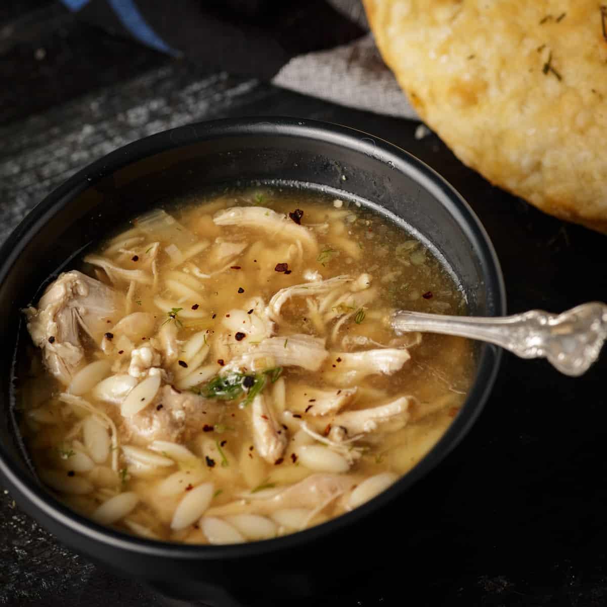 A bowl of lemon orzo chicken soup