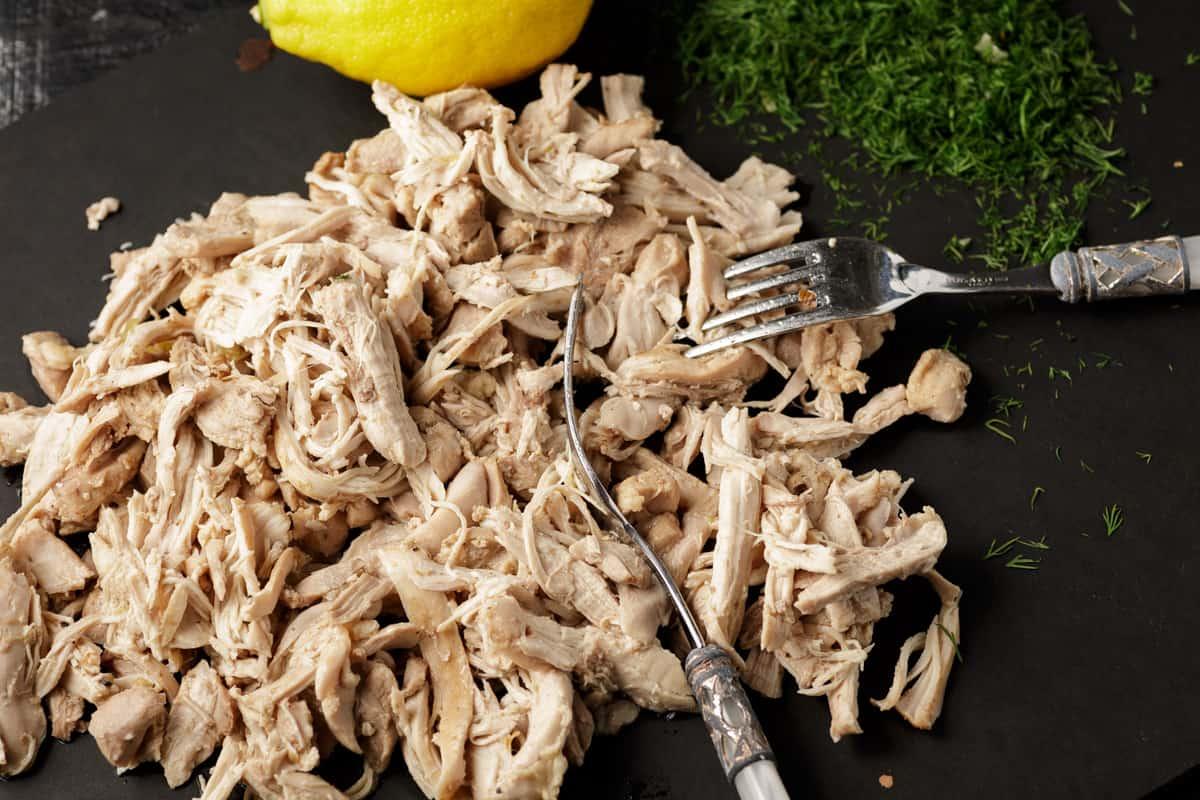 Shredded chicken on a cutting board