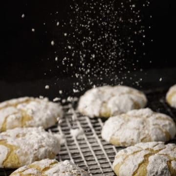 Powdered sugar floating down onto lemon cookies