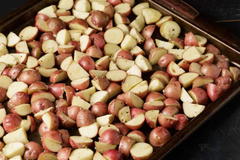 A baking sheet of raw red potatoes