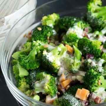 A bowl of broccoli salad with a yogurt dressing