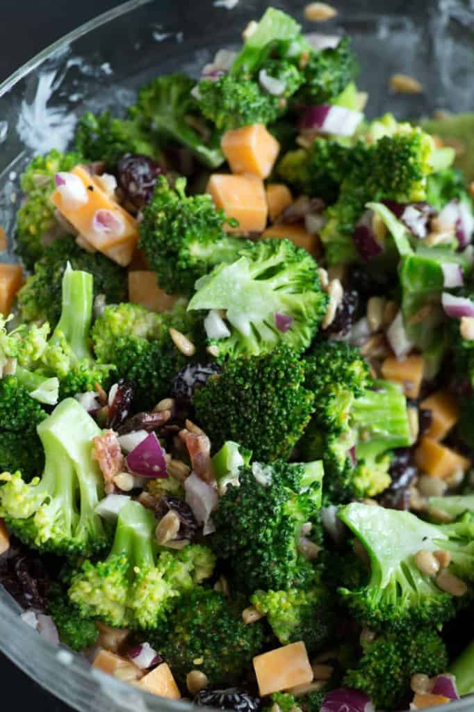 Broccoli salad tossed in a bowl