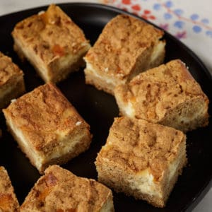 A platter of carrot cake cheesecake bars