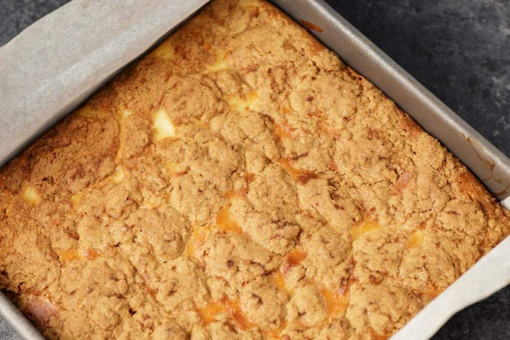 Baked carrot cake cheesecake bars in the pan