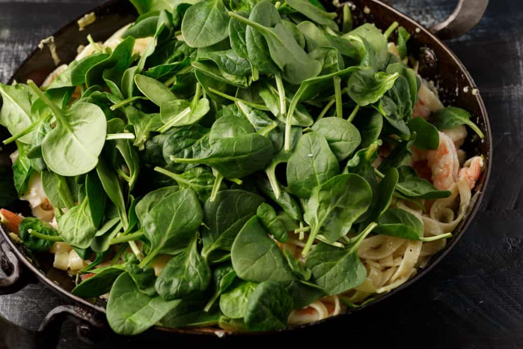 Fresh spinach added to pasta