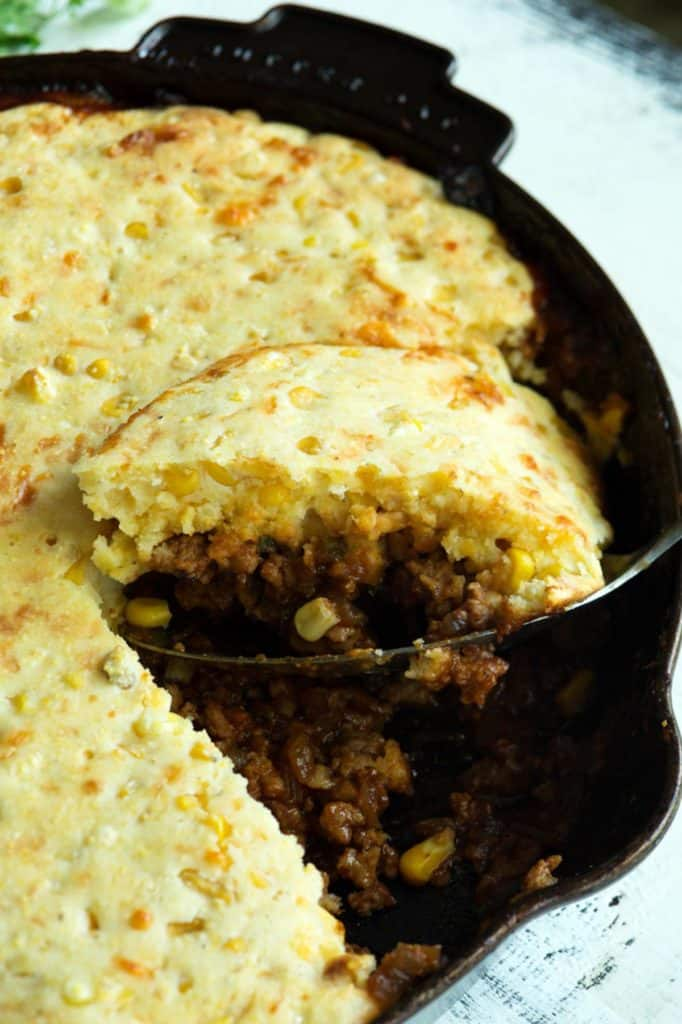 A skillet of sloppy joes with cornbread