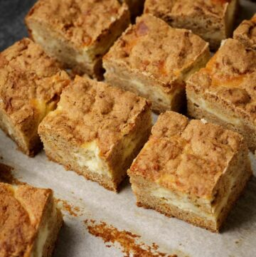 Cheesecake bars on parchment paper