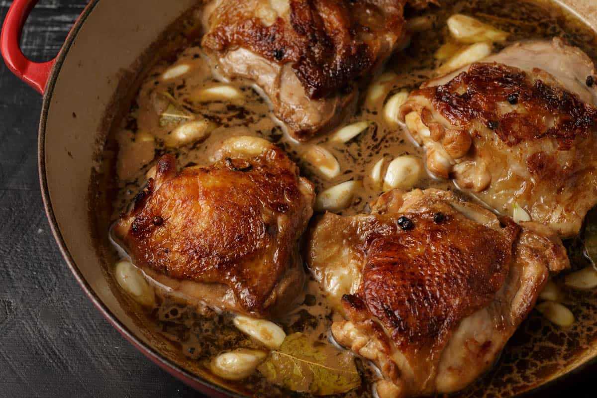 Chicken and marinade in a skillet
