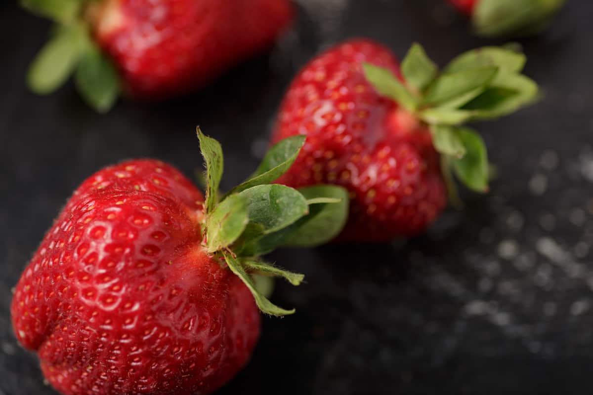 Three perfectly ripe strawbeerries