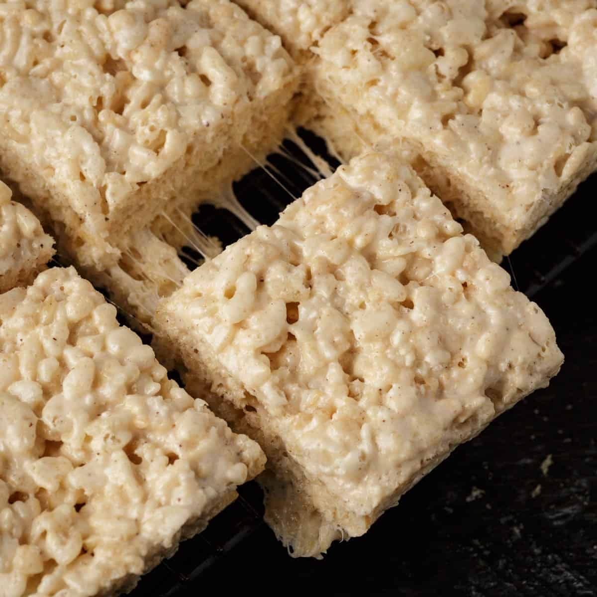 A brown butter Rice Krispie treat being pulled away from the rest.