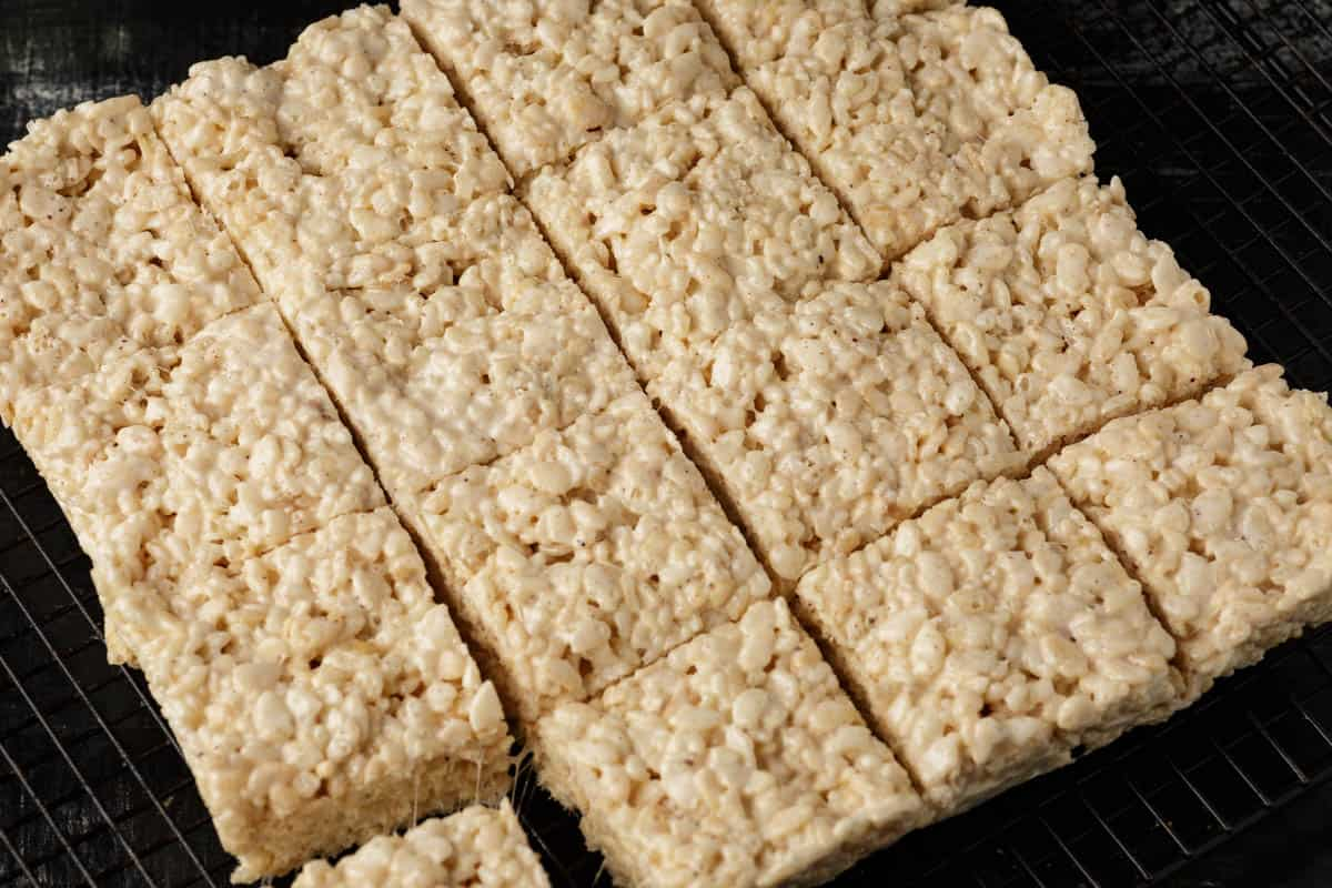A batch of Rice Krispie treats cut into squares.