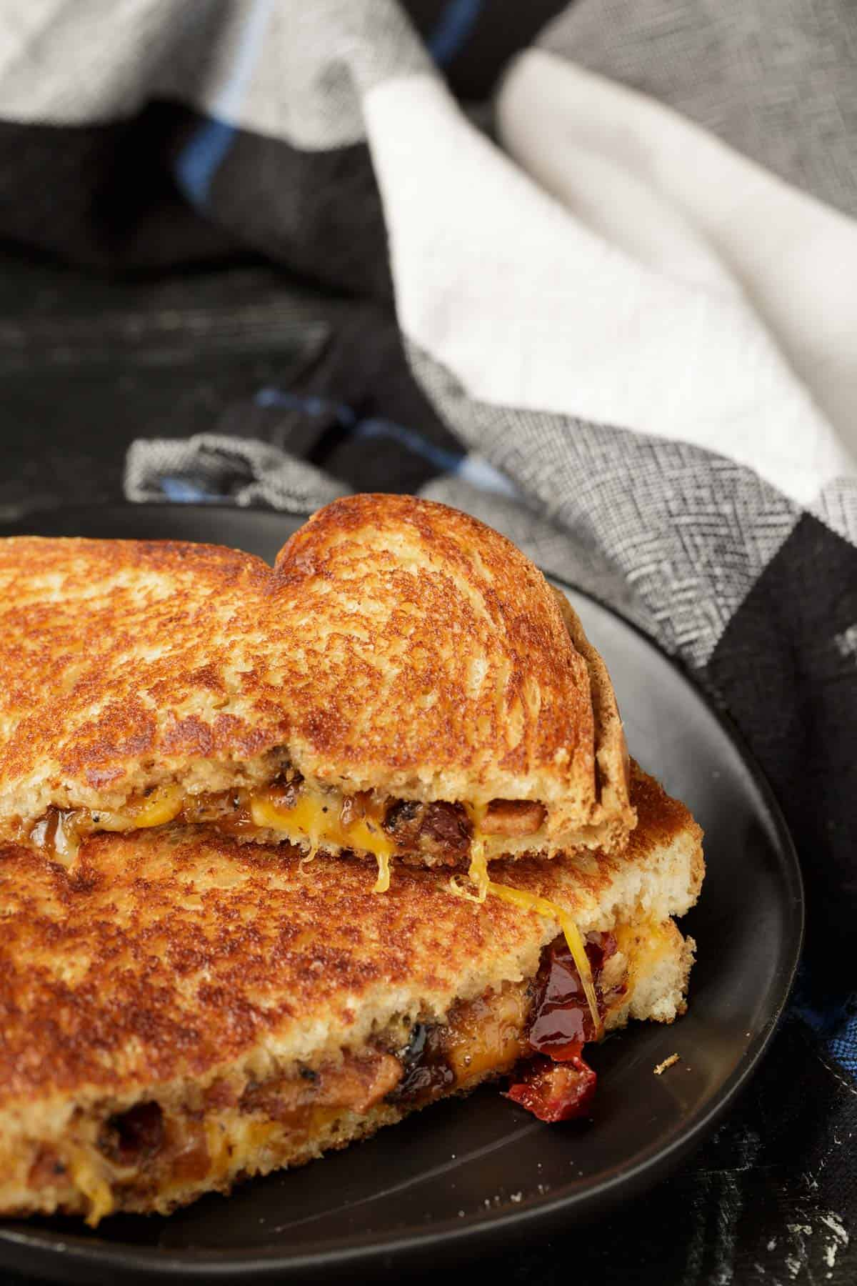 A grilled Cheese with bacon peach jam.
