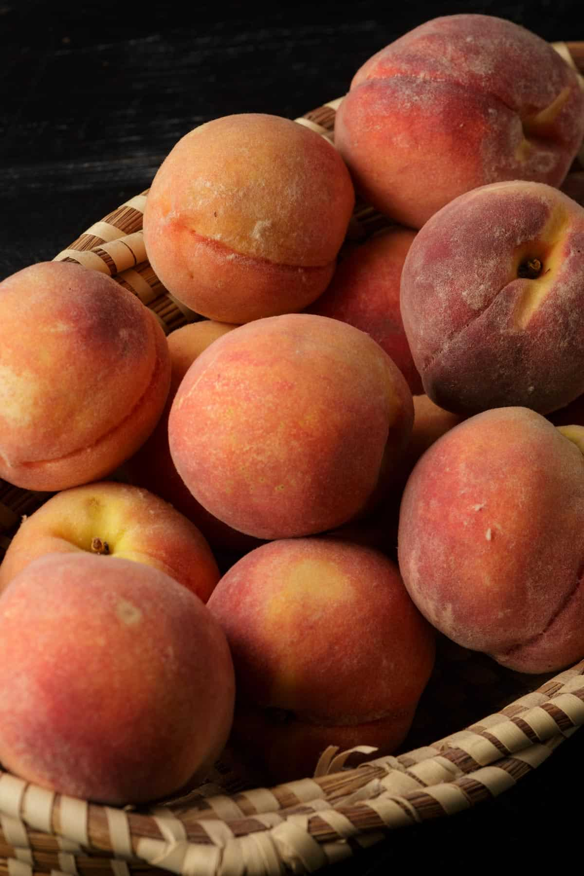 A basket with peaches from the farmers market
