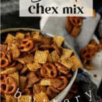 Bold Chex mix spilling out of a bowl.