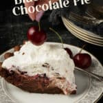 A slice of chocolate Black Forest Pie with a cherry on top.