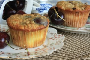 Two Cherry Cheesecake Muffins on plates